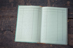 Old Note book on wood Royalty Free Stock Photography