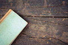 Old Note book on wood Stock Photo