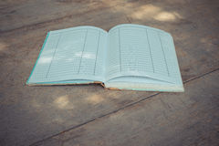 Old Note book on wood Royalty Free Stock Photo