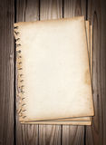 Old note papers on brown wood texture Royalty Free Stock Photography