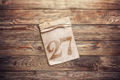 Old notebook. On a old brown wooden background Royalty Free Stock Photography