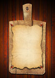 Old Notebook Cutting Board on Wood Background Royalty Free Stock Images