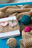 Old notebook with knitted cover with felt heart Royalty Free Stock Photo