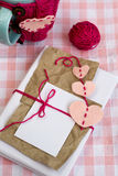 Old notebook for love notes and and a  cup in a sweater. Old notebook for love notes and and a blue cup in a sweater Stock Image