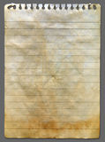 Old notebook paper. Empty white Crumpled Old notebook paper on gray background vertical Royalty Free Stock Photography