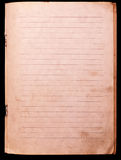 Old notebook paper. Old and worn notebook paper isolated on black royalty free stock photos