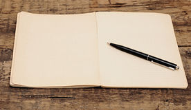 Old notebook with pen Stock Images