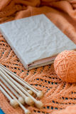 Old notebook for records, ball of yarn and knitting needles Stock Photos