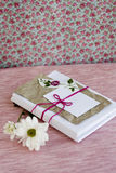 Old notebook with a white flowers for love notes Royalty Free Stock Image