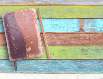 Old notebooks and pencil on wooden table. Old notebooks and pencil on business wooden table or office desk top view with copy space for design and use stock image