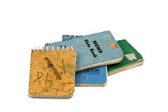 Old Notebooks. Worn and used pocket spiral notebooks. Isolated royalty free stock image