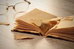 Old notepad and glasses Stock Photography