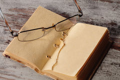 Old notepad and glasses Royalty Free Stock Image