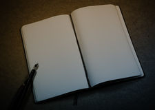 Old notepad, ink pen and inkwell Royalty Free Stock Photos