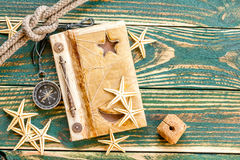 Old notepad with seashells Royalty Free Stock Images