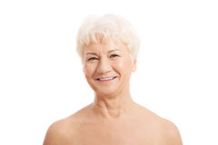 An old nude woman's head and shoulders. Isolated on white Stock Photos