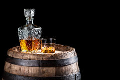 Old oak barrel and a glass of Scotch Stock Image