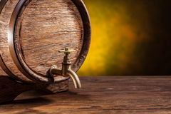 Old oak barrel on a wooden table. Stock Photos