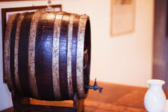 Old oak barrel on a wooden table Stock Photo