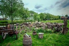 Old oak barrels of beer. Were piled on the lawn royalty free illustration
