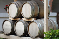Old oak barrels. Pile of old oak wooden barrels royalty free stock images
