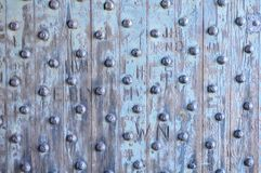 Old oak door with iron rivets Stock Images