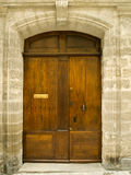 Old oak door in stone frame. Old oak door with carved stone surround Royalty Free Stock Photo