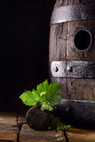Old oak wine barrel with vine leaves Stock Photo