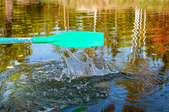 The old oars. Green paddle with splashes of water. close-up Stock Images