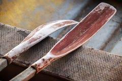 Old oars in small fishing boat. Old oars lie in small fishing boat Stock Images