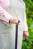 Old obese woman walking with stick. Vertical Stock Photos
