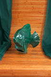 Old object ,green fish piece of pottery Royalty Free Stock Image