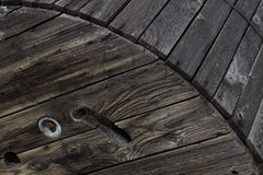 An old object in a railway station in Italy. Old wooden wheel in a railway station Royalty Free Stock Photo