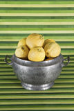 Old object : tureen with lemons , green background Stock Photo