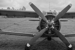 Old plane in black and white colors. An old obsolete aircraft propeller on sky fon Royalty Free Stock Image