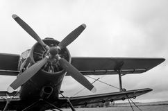 Old plane in black and white colors. An old obsolete aircraft propeller on sky fon Royalty Free Stock Photography