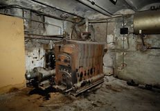 Old and obsolete in the basement of a house for a boiler room. Room in the basement of a boiler stock photo