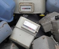 Old obsolete disused gas counters in a landfill of toxic waste Stock Image