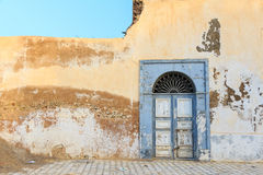 Old obsolete door. Old wooden old door on wall in oriental style Royalty Free Stock Images