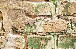 Old obsolete painted brick wall closeup Royalty Free Stock Photos