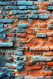 Old obsolete rusted red brick wall. Old obsolete red brick wall covered with cyan rust Royalty Free Stock Photo
