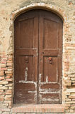 Old obsolete vintage door. In Tuskany Royalty Free Stock Photo