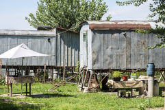 Old obsolete wagons used for homes Stock Photos