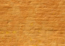 Old ochre yellow painted brick wall background Stock Images
