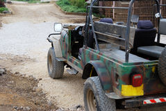 Old off-road car. In military camouflage Stock Images