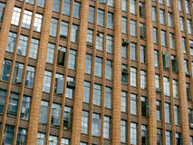 Old office building. The windows of an old urban office building royalty free stock image