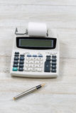 Old Office Calculator on Wooden Desktop Royalty Free Stock Image