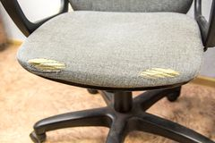 Old office chair, cloth rubbed to holes. Old office chair rubbed to holes stock photo