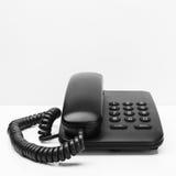 Old office desktop phone. On white desk Royalty Free Stock Photo