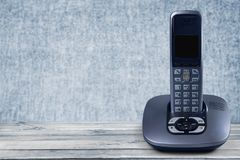 Old office phone on wooden table stock image